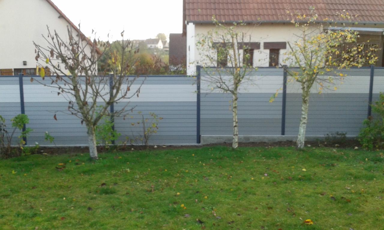 Réalisation d'une clôture en lames composites