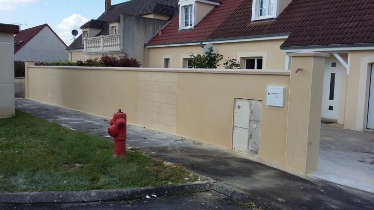 Démolition et Reconstruction d'un mur de clôture fissuré